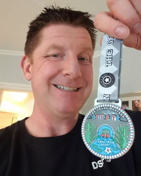 Allan Kay with GWC medal