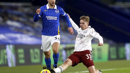 Arsenal's Emile Smith Rowe (right) tackles Brighton and Hove Albion's Joel Veltman during the Premie