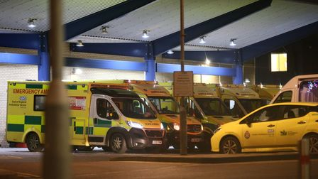 Ambulances outside Queen's Hospital in Romford, London, which has moved into the highest tier of cor