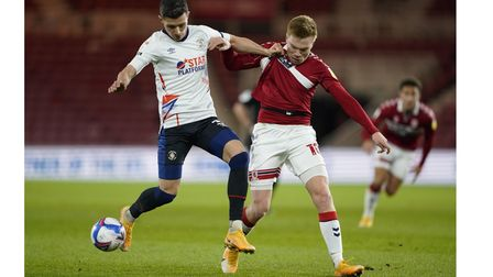 Luton Town's Dan Potts (left) and Middlesbrough's Duncan Watmore battle for the ball during the Sky
