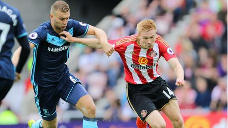 Sunderland's Duncan Watmore (right) and Middlesbrough's Ben Gibson battle for the ball during the Pr