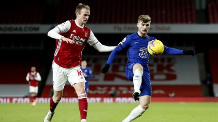 Arsenal's Rob Holding (left) and Chelsea's Timo Werner battle for the ball during the Premier League