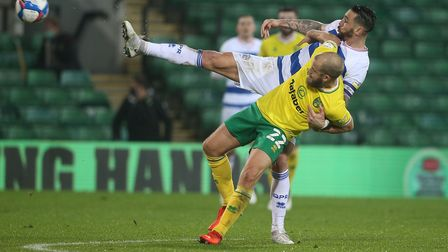 Teemu Pukki of Norwich and Geoff Cameron of Queens Park Rangers in action during the Sky Bet Champio