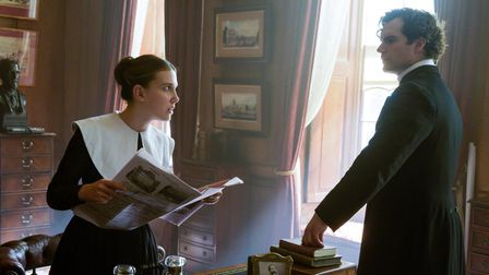 Millie Bobby Brown as Enola Holmes and Henry Cavill as Sherlock Holmes