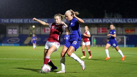 Arsenal women's Leah Williamson (left) and Chelsea women's Pernille Harder battle for the ball durin