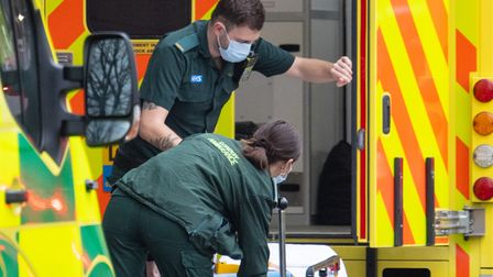 An ambulance crew load an empty bed onto an ambulance outside the Royal London Hospital, in London.