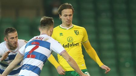 Todd Kane of Queens Park Rangers and Kieran Dowell of Norwich in action during the Sky Bet Champions