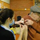Terence Phillips from Ilfracombe receives his Covid-19 vaccination at North Devon Leisure Centre