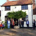 Members of the community group outside the Locks Inn, in Geldeston.