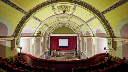 Inside the Paignton Picture House with seats all facing down to the screen