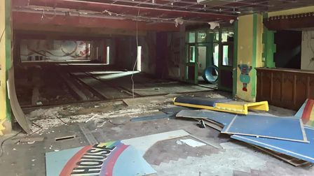 Inside theformer Rainbow Fun House children's soft playcentre, with advertising hoardings laid on the floor and ceiling hanging down