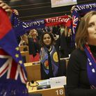 MEs hold up scarves during a ceremony prior to the vote on the UK's withdrawal from the EU. (AP Phot