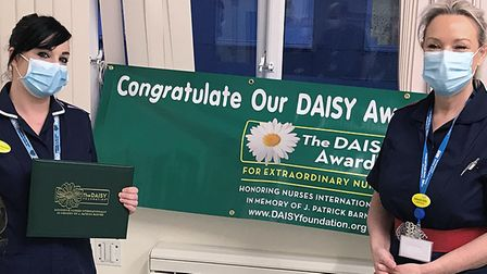 Christina Harrison receives her DAISY award and certificate