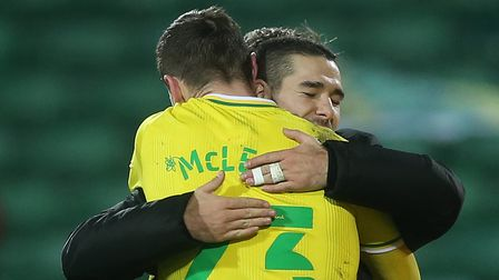 Emiliano Buendia of Norwich and Kenny McLean of Norwich at the end of the Sky Bet Championship match