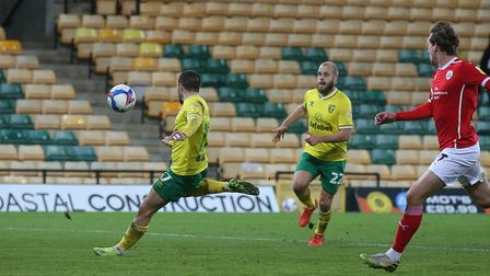 Emiliano Buendia of Norwich scores his sides 1st goal during the Sky Bet Championship match at Carro