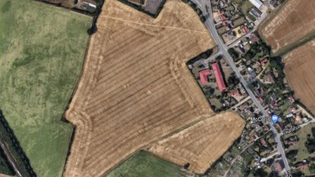 This brown arable field next to and behind Reeve Lodge in Trimley St Martin could see around 140 new homes plus primary school and early years centre