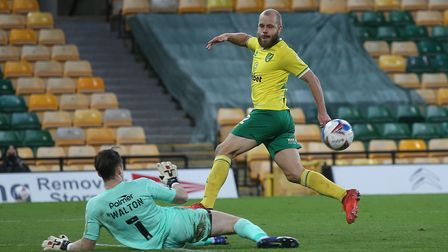 Jack Walton of Barnsley saves at the feet of Teemu Pukki of Norwich during the Sky Bet Championship