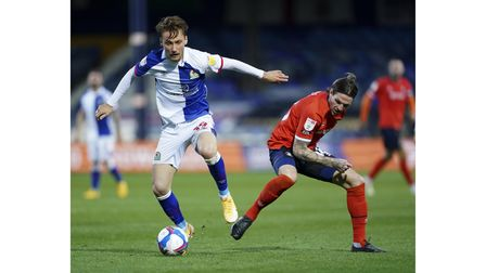 Luton Town's Glen Rea (right) and Blackburn Rovers' Tom Trybull battle for the ball during the Sky B