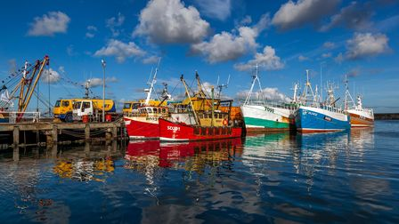 Many of the big colourful fishing boats moor against The Mary Williams Pier