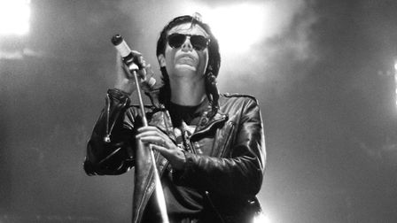 Sisters of Mercy frontman Andrew Eldritch performs on stage at Wembley Arena, London, in 1990. Pictu