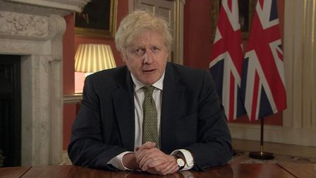 Prime Minister Boris Johnson making a televised address to the nation from 10 Downing Street, London
