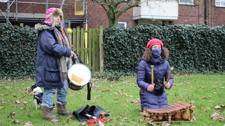 Protesters sing and play music as The Happy Man Tree is chopped down.