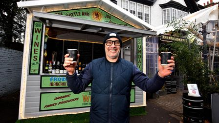 """Heath Ball, landlord of The Red Lion & Sun in Highgate, outside the """"Christmas chalet""""."""