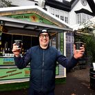 "Heath Ball, landlord of The Red Lion & Sun in Highgate, outside the ""Christmas chalet""."