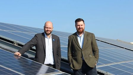 Hackney's Mayor and Environment chief Jon Buke stand in front of solar panels.