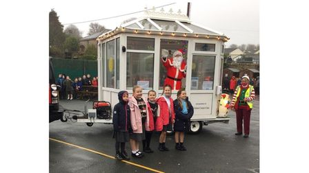 A picture of Santa Claus at a school