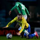 Connor Lemonheigh-Evans of Torquay United battles for the ball with Emmanuel Sonupe of Yeovil Town d