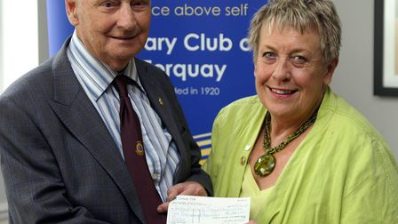 Peter Hosking receiving a cheque from the Rotary Club in 2016