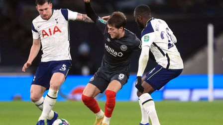 Brentford's Mathias Jensen battles for the ball with Tottenham Hotspur's Tanguy Ndombele (right) and