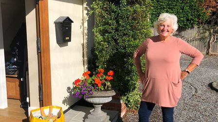 Sid Valley Help volunteer, Gill Stennett delivering shopping to a client during last summer