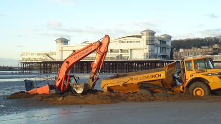 Digger and truck stuck on Weston Beach