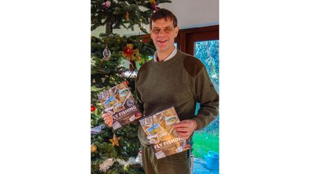 Duncan Hall with his new fishing book