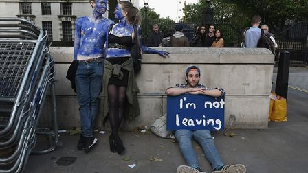 A young couple painted as EU flags protest on outside Downing Street against the United Kingdom's de