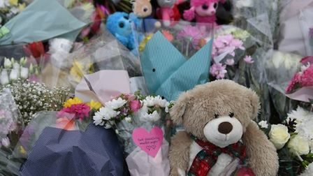 Flower tributes left for two children who died in a house fire in St Neots.