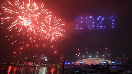 Fireworks and drones illuminate the night sky over the The O2 in London as they form a light display