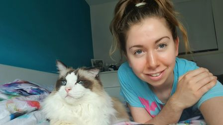 Jenna Silk with Asher, a cat she has fostered for Blue Cross