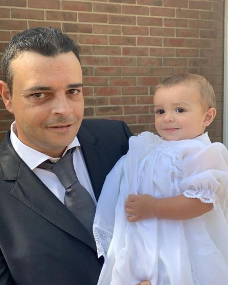Father pictured with baby son