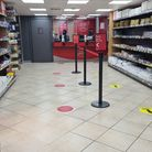 Post Office counters at the end of shelves of stationary