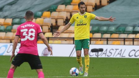 Jason Knight of Derby County and Lukas Rupp of Norwich in action during the Sky Bet Championship mat