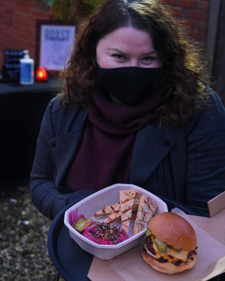 Landlady of the Black Horse, Rose Hanison, with one of her Lockdown 3 takeaways, beef burger and hum
