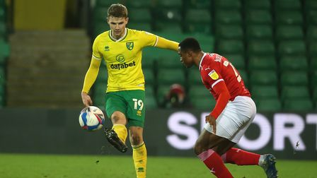 Jacob Sorensen of Norwich and Victor Adeboyejo of Barnsley in action during the Sky Bet Championship
