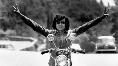 The Sammarinese singer Little Tony, born Antonio Ciacci, poses on a motorbike with open arms. Rome (