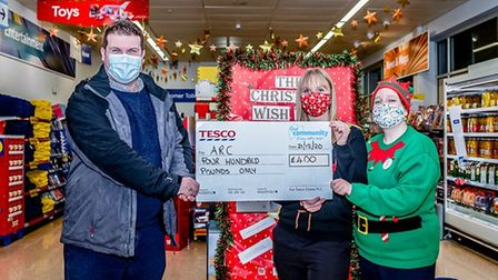 Store manager Helen Collins and customer assistant Maria Henson present a £400 cheque to Arc's Craig Billington