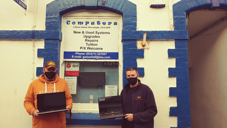Gary Arlett and Andrew Marshall are appealing for donated laptops pictured outside Computers in Barnstaple with laptops