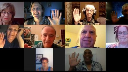 A screenshot of several older people in a zoom session.