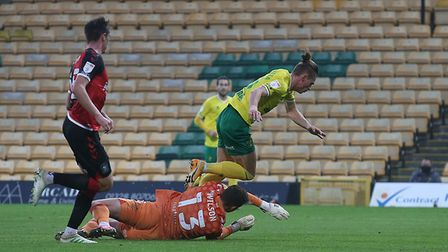 Przemyslaw Placheta of Norwich is brought down in the box by Ben Wilson of Coventry City and a penal